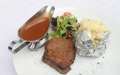 Beef Medalion Steak with Gravy Sauce, Baked Potatoes and Salad